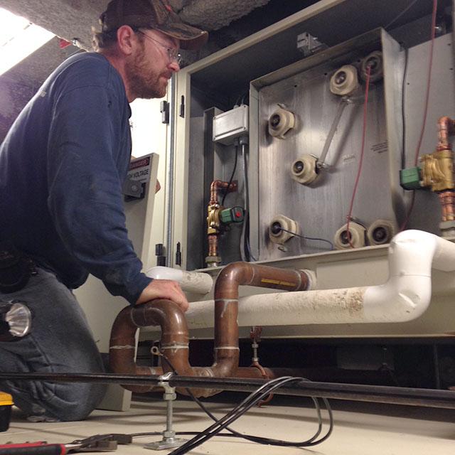 Technician Repairing Electrostatic Cell